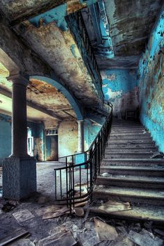 I love the color of the blue peeling paint with the contrast of the ashen stairs and yellowed walls.