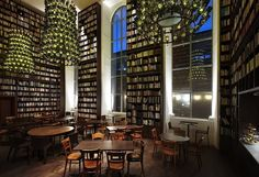 The Lobby lounge & wine bar at the B2Hotel in Zurich, with 30,000 books and 3 chandeliers made entirely from empty wine bottles. The hotel was formerly the Hurlimann brewery, founded in 1836.
