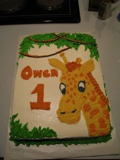Nephew wanted a jungle theme birthday.  Chocolate/White marble cake with buttercream frosting.  Drew giraffe by hand off of invitation.  One antler has an issue. :)