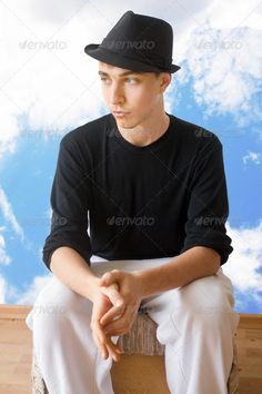 Thinking youth on the edge ...  adult, attractive, black, boy, boyfriend, calm, casual, caucasian, complicated, confused, contemplating, decision, emotion, expression, face, facial, feeling, focused, future, hands, handsome, hat, life, male, man, on edge, person, portrait, pose, pressure, serious, sitting, solitude, sport, staring, strategy, stressed, sweater, thinking, thought, wearing, white, young, youth