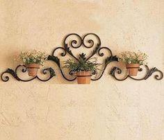 Resultado de imagen para maceteros de pared de hierro
