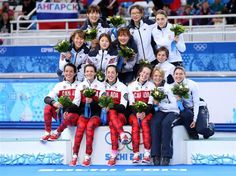 DAY 12:  Medalists from South Korea, Canada and Italy celebrate on the podium during the flower ceremony for the Short Track Ladies' 3000m Relay