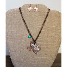 Original Cowgirl Clothing Co. Copper Texas Pendant Necklace & Earrings ($15) ❤ liked on Polyvore featuring jewelry, earrings, charm pendant necklace, copper pendant necklace, western charms, charm jewelry and cowgirl earrings