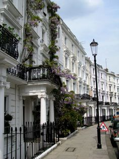 Notting Hill, London ~ this looks very similar to the road that our hotel was on in Kensington at Notting Hill Gate. All of the townhomes must be painted in Magnolia.