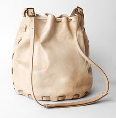 simple and beautiful bucket bag with belt-strapping construction detail, handmade and hand stitched by All Hands Black Leather Backpack, Leather Pouch, Leather Shoulder Bag, Leather Bags, Tan Leather, Shoulder Bags, Shoulder Strap, Embellished Shoes, Best Bags