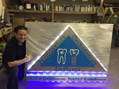 Brushed Aluminum and LED lighted sign by artist Tony Viscardi. LED sign,LED signs