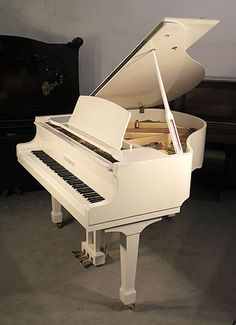 A nearly new, Steinhoven Model 148 baby grand piano with a white case and spade legs. Piano has an eighty-eight note keyboard and three-pedal lyre. £5000