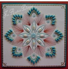 Beautiful! Beads, stitches and art string.