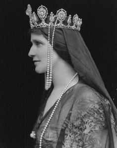 E. O. Hoppé - Lady Nancy Astor (nee Langhorne), wife of Viscount William Waldorf Astor, wearing elaborate headpiece composed of crown (probably set with Sancy diamond which belonged to Queen Elizabeth I) and drape of fabric and pearls.