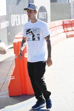 Justin Bieber wearing Thrasher Boyfriend T-Shirt in White and Adidas Originals Tubular Doom Pk in Night Marine & White