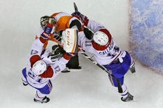 Montreal Canadiens' Brian Gionta (21) and Brendan Gallagher (11) fight with Philadelphia Flyers' Steve Mason