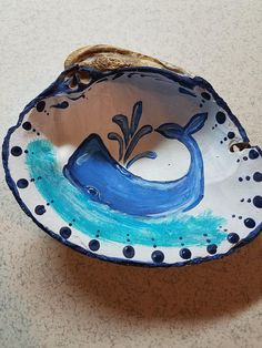 I painted this cute whimsical whale on a seashell I picked up on a beach in Dauphin Island, AL. Would be great as a gift and displayed in a childs room or a nautical themed living or family room. Seashell Painting, Seashell Art, Seashell Crafts, Beach Crafts, Summer Crafts, Stone Painting, Painted Driftwood, Painted Shells, Rock Crafts
