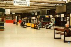 Piccadilly Station late eighties. As I remember there were public toilets and a barbers downstairs in the basement at the far end of the ticket hall.