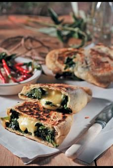 Calzone stuffed with spinach and smoked mozzarella