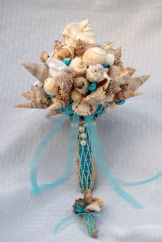 Blue+Seashell+Bouquet+and+Boutonniere+Set/+by+SlyCreationsBouquets,+$118.00