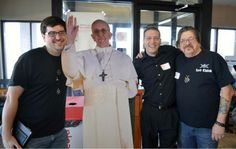 Wiccans pose with Pope cutout.