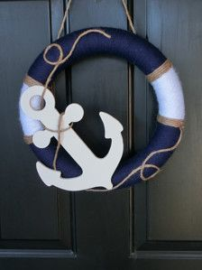 A handmade 14 wreath wrapped in navy blue and white yarn. This wreath has been decorated with a hand-painted wooden anchor and twine. This will make a great addition to your home or boat.  This wreath is recommended for indoor use, behind a storm door, or on a door with a covered porch. You will want to try and keep it away from Mother Natures elements.