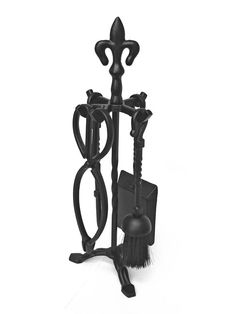 Fleur De Lys Companion Set - This iron companion set with black cast finials is an elegant fireside accessory. The holder and each tool is capped off with a black cast finial on the top.