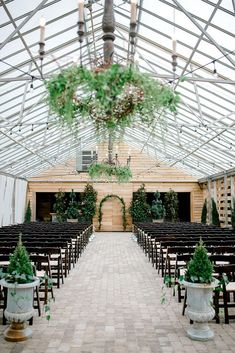 Who knew a greenhouse wedding could be so dreamy and magical? This wedding venue is the perfect balance of chic and rustic. You can include any type of floral you'd like to make it fir all your special details. For more ideas, head to the link to read now!  #greenhousewedding #indoorwedding #weddingideas #winterwedding