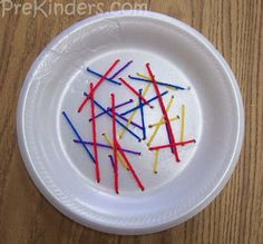 Styrofoam plate sewing w/ yarn and plastic needles.