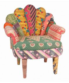 Take a seat in the lap of luxury when sitting on this lovely peacock chair. The unique and vintage Indian kantha fabric makes each chair a one-of-a-kind addition to home décor. Feel the enticement of old-world charm and enjoy an exotic comfort that'll last for years to come.Note:This one-of-a-kind item is made from vintage fabric and may appear in colors or patterns other than shown.Chair: 29'' W x 20'' H x 33'' DSeat: 19'' H x 17'' D39 lbs.Kantha vintage cotton / mango woodSpot…