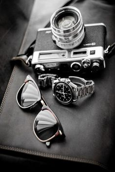 Camera + Sunglasses + Watch = The right combination for a right Gentleman