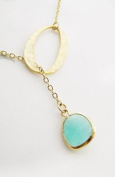 Matte gold finish hammered O ring charm with Sea