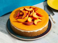 This No-Bake Peaches-and-Cream Cheesecake recipe from Justin Chapple gets its flavor from graham crackers, whole-milk ricotta cheese, and fresh peaches. Get the recipe from Food & Wine.
