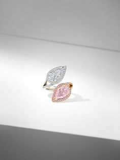 Each ring in the Gemini Collection features two exquisite stones that sit side-by-side in perfect harmony. The unique beauty of each jewel is heightened by proximity to its twin, with each bringing out the finest qualities of the other.  'The Boodles Pink' Gemini ring features two pear-shaped diamonds, one 'D' colour, internally flawless and one fancy intense purplish pink, each over three carats and a perfect match.