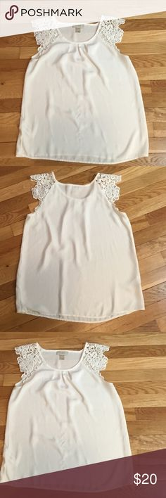 Ann Taylor Loft sleeveless shirt Ann Taylor loft  Floral sleeveless top.  100% Polyester.  Off white.  No rips or stains Ann Taylor Tops Blouses