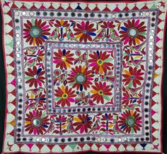 floss silk , with mirror work, vintage wall hanging from Rajasthan. 70cm x 67cm http://worldbasket.co.uk/product-category/antique-and-vintage-textiles/