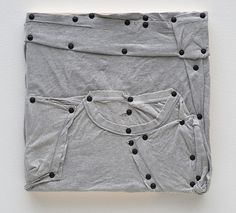 Tom Burr.His personal effects (grey, one), 2012, men's t-shirt, upholstery tacks and wood, 15 x 15 inches (38.1 x 38.1 cm)