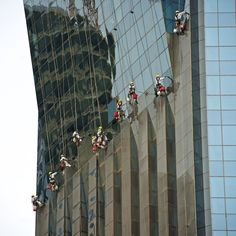 Window washers on the side of a building in Doha, Qatar. Photo by James Duncan Davidson.