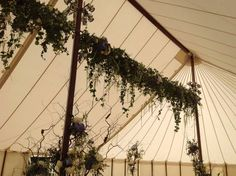 Flowers and ivy cascading from the marquee roof #marquee #hangingflowers created by http://www.jadesflowers.co.uk in Essex, UK