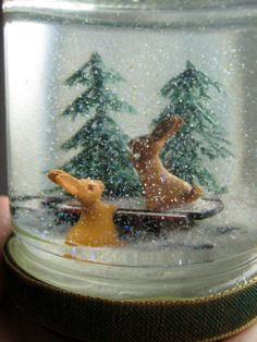 snow globes from around the world | Rabbits and Sled in PIne Forest Snow Globe -- Vintage Style Glass Jar ...