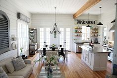 Perfect arrangement for the living/kitchen space. Farmhouse in Texas by Magnolia Homes