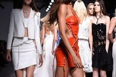 Models present creations by Italian fashion designer Donatella Versace during the Haute Couture Spring-Summer 2016 Versace collection show in Paris on January 24, 2016.  / AFP / MIGUEL MEDINA        (Photo credit should read MIGUEL MEDINA/AFP/Getty Images)