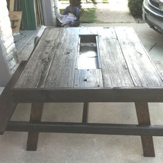 Picnic table with cooler in the middle...all made with recycled wood