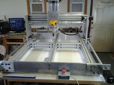 CNC Table top mounts installed on frame. For attaching temp MDF top.