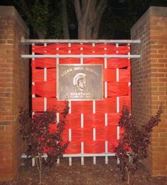 ENTRANCE GATE TO SALEM HIGH SCHOOL. We used full sized $$ store table cloth's to weave into the fencing here.