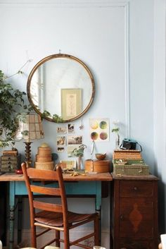 I love this oval mirror old chair and desk office space
