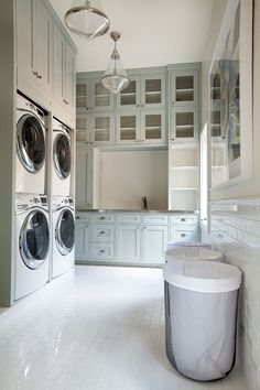 Traditional Laundry Room with Luxetile white subway tile, Brick floors, Built-in bookshelf, Top ranking enterprise