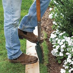 An Easy Way to Edge a Lawn - what a great idea for a straight edge!!!