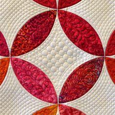 close up of quilting: Orange Peel quilt, designed by Ellen Granda and Carol Swartz, quilted by: Donna Derstadt. Village Quilters Guild 2015 raffle quilt.