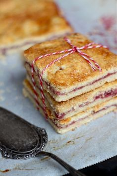"Buttery shortbread squares with raspberry filling - known in Denmark as Hindbærsnitte - Bake them and love them - a great recipe via this blog, ""Minta Eats""."