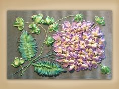 I  ribbon embroidery . . . How to embroider a silk ribbon hydrangea & ivy group. www.craftyattic.com shows you how to embroider this beautiful hydrangea and ivy group in pure silk ribbon. All of the techniques you will need to embroider this panel are included.