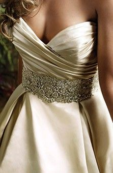 ok, so I know its not lace, but this dress by Lazaro is gorgeous!