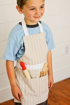 Child's Apron PDF Pattern (6 versions, ages 2-12)...download, print, and cut out the pattern size you need!   via Make It and Love It