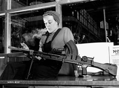 """--unknown photographer, Veronica Foster, employee of the John Inglis Co. (known as """"The Bren Gun Girl"""" posing in Toronto, 1941, NFB archives) """""""