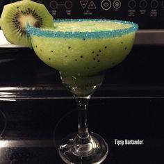 ELECTRIC KIWI MARGARITA 1 1/2 oz. (45ml) Tequila 1 oz. (30ml) Midori 1 oz. (30ml) Sweet & Sour 1/2 oz. (15ml) Lime Juice Kiwi Ice Blend Splash Blue Curacao Blue Sugar Rim